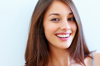 Buy stock photo Closeup of a naturally pretty young girl with great skin and teeth, smiling pleasantly at the camera with copyspace