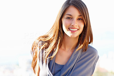 Buy stock photo Portrait of beautiful young woman giving you an attractive smile