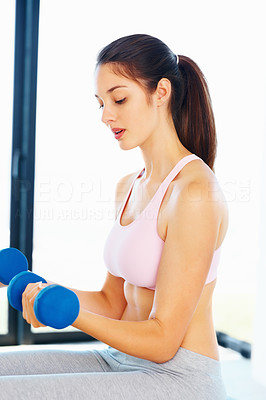 Buy stock photo Healthy young girl working out with dumbbells
