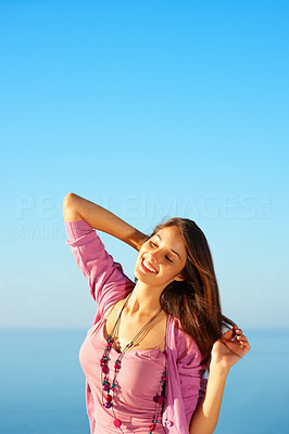 Buy stock photo Cute young girl enjoying outdoors with hand behind head - copyspace