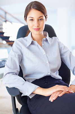 Buy stock photo Portrait of cute female executive sitting on an office chair