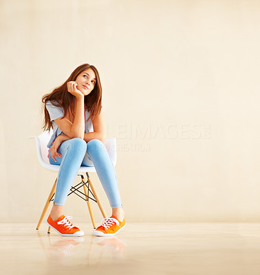 Buy stock photo Full length of trendy young girl sitting on a chair and daydreaming - copyspace