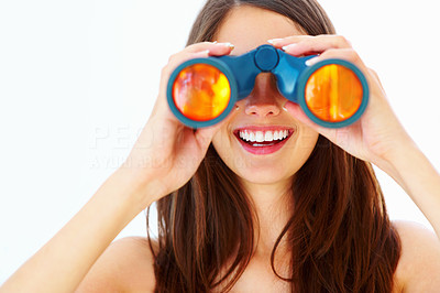 Buy stock photo Closeup of beautiful girl looking through binoculars and smiling on white background