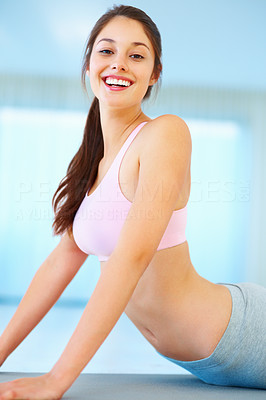 Buy stock photo Portrait of young woman smiling while meditating during workout session