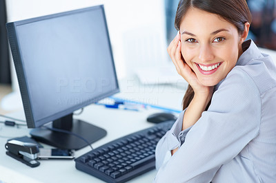 Buy stock photo Portrait of cute young female executive sitting at table and smiling