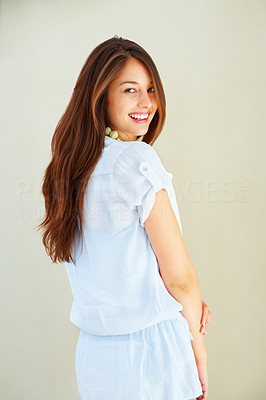 Buy stock photo Portrait of pretty woman turning and giving you an attractive smile