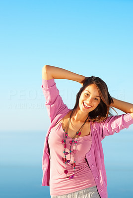 Buy stock photo Portrait of pretty woman standing against sky and smiling