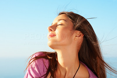 Buy stock photo Closeup of an attractive young female enjoying the sunny weather
