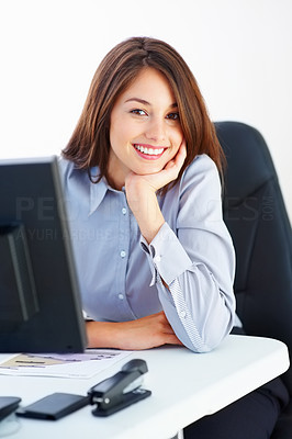 Buy stock photo Portrait of young businesswoman sitting at table with hand on chin and giving you cute smile