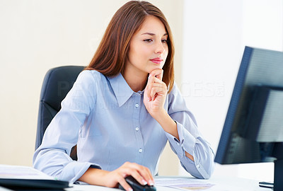 Buy stock photo Busy female executive sitting at an office table and working on computer