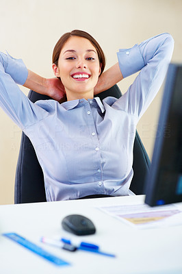 Buy stock photo Portrait of young business woman relaxing at work with hands behind head