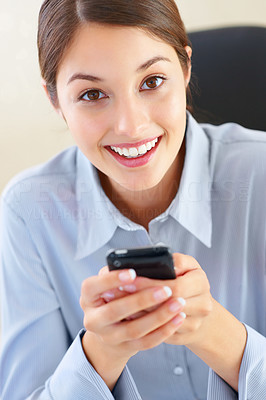 Buy stock photo Closeup of beautiful young business woman using cellphone and giving you cute smile