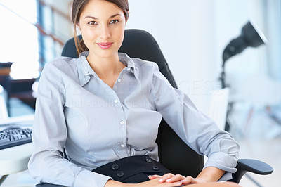 Buy stock photo Portrait of an attractive female executive sitting on an office chair