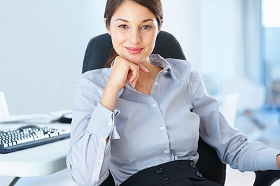 Buy stock photo Portrait of young business woman sitting on office chair with hand on chin and smiling