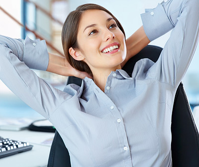 Buy stock photo Young smiling business woman in office relaxing with hands behind head and looking away