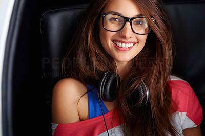 Buy stock photo Closeup of cute smiling woman wearing glasses and headphones sitting on chair