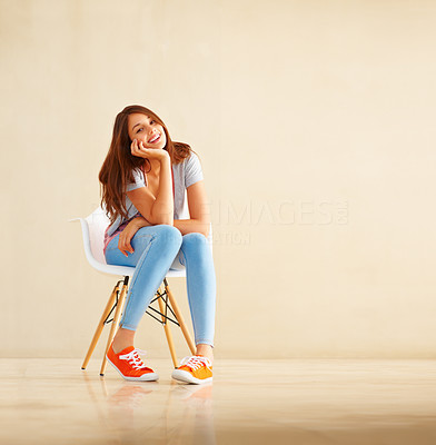 Buy stock photo Full length of girl sitting on chair and giving you an attractive smile