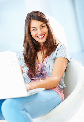 Buy stock photo Portrait of pretty woman sitting in chair using laptop and smiling