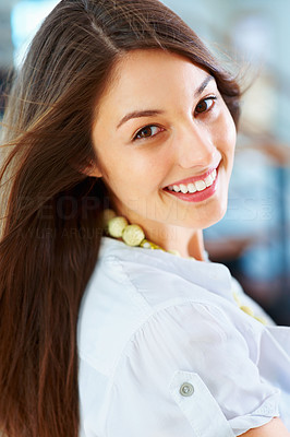 Buy stock photo Closeup of an attractive young woman giving you warm smile