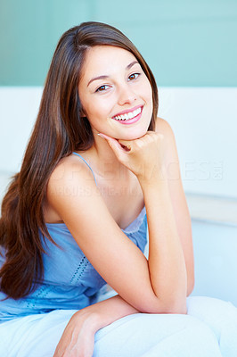 Buy stock photo Smiling young woman resting her hand on chin