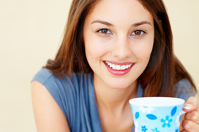Buy stock photo Closeup portrait of beautiful young woman holding coffee cup on plain background