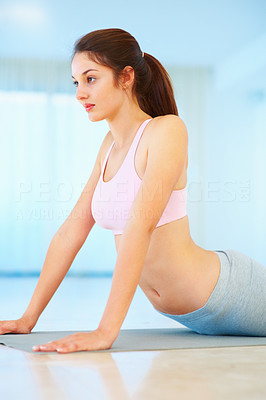 Buy stock photo Fitness young woman practicing stretching exercise on mat