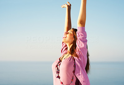 Buy stock photo Beautiful young woman with hands raised against sky - copyspace