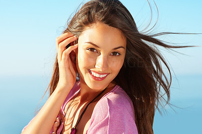 Buy stock photo Closeup of pretty young woman smiling with windswept hair