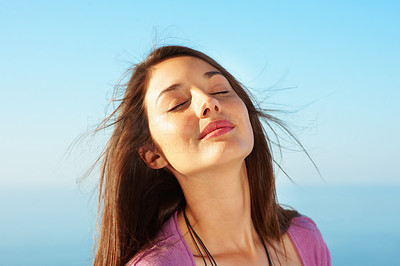 Buy stock photo Closeup of beautiful young woman with eyes closed against sky