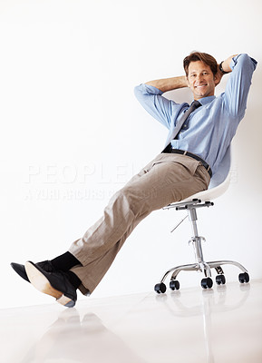 Buy stock photo Portrait of a relaxed young businessman sitting on the chair