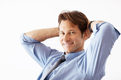 Buy stock photo Portrait of a happy young businessman sitting relax against white background