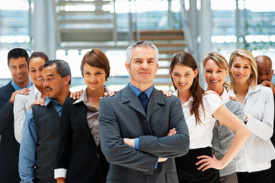Buy stock photo Group of executives resting hands on each others shoulders