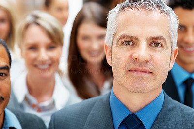 Buy stock photo Executive with team in background