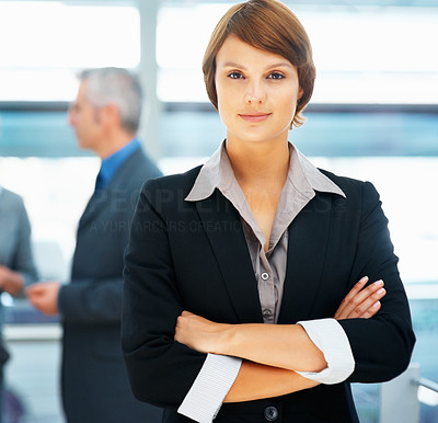 Buy stock photo Young female executive with arms folded indoors