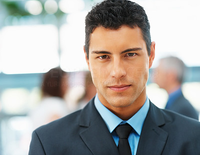 Buy stock photo Closeup of businessman with team in distance