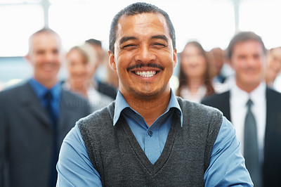 Buy stock photo Friendly executive with team of colleagues in background
