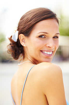 Buy stock photo Closeup portrait of a gorgeous young woman looking behind and smiling - Outdoor