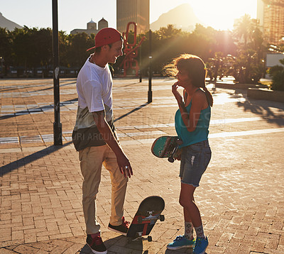 Buy stock photo Shot of two skaters talking