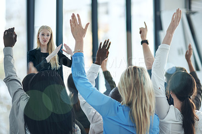 Buy stock photo Shot of a group of people raising their hands in a class
