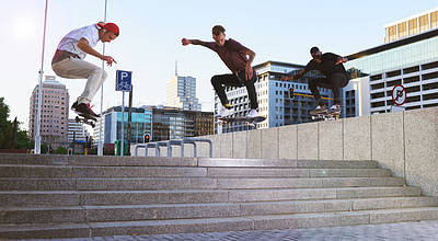 Buy stock photo Shot of young men skating down a flight of stairs