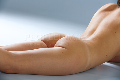 Buy stock photo Shot of a females curvaceous behind isolated on gray