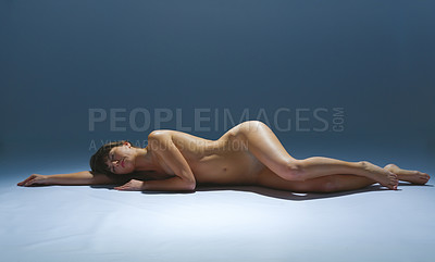 Buy stock photo Shot of a beautiful nude woman posing on her side