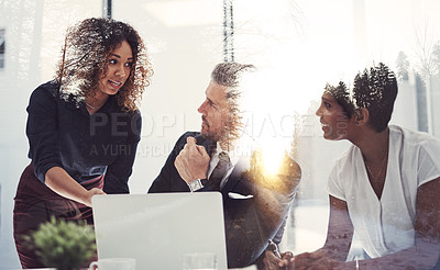 Buy stock photo Shot of a team of businesspeople in a meeting superimposed over a natural landscape