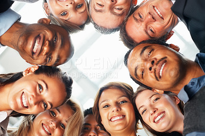 Buy stock photo Low angle view of executives looking down and smiling
