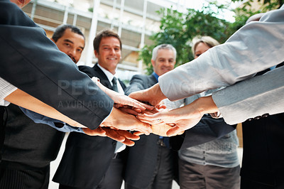 Buy stock photo Colleagues piling hands on top of one another