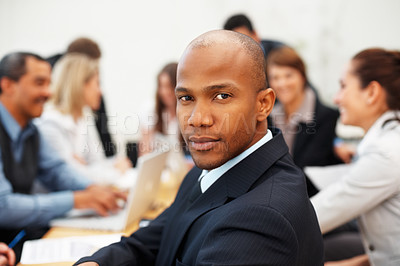 Buy stock photo African American business man with team in background during meeting