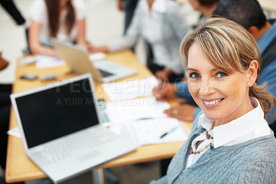 Buy stock photo Business woman sitting near laptop during company meeting