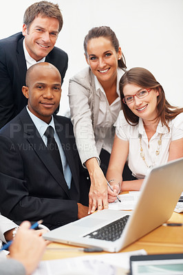 Buy stock photo Portrait of smiling group of executives with laptop on table