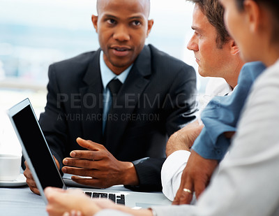 Buy stock photo Executive talking to colleagues about proposal