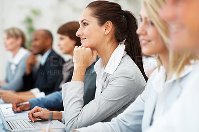 Buy stock photo Attractive business woman smiling during meeting with colleagues